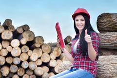 Female lumber engineer showing ok sign Stock Photo