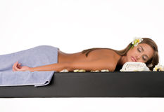 Female during luxurious procedure of massage Stock Photos