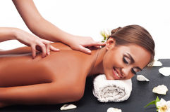 Female during luxurious procedure of massage Royalty Free Stock Photography
