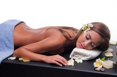 Female during luxurious procedure of massage Stock Photo