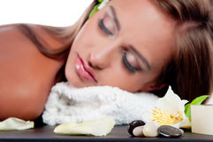 Female during luxurious procedure of massage Stock Images