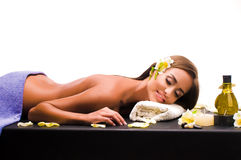 Female during luxurious procedure of massage Royalty Free Stock Photos