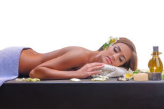 Female during luxurious procedure of massage Royalty Free Stock Images