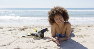 Female lying on beach with flippers Stock Images