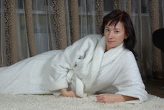 Female lying on a carpet Stock Images