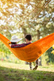 Female lying down in hammock and rest Royalty Free Stock Photography