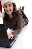 Female lying on floor working on laptop Stock Images