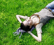 Female lying on the grass Royalty Free Stock Photos