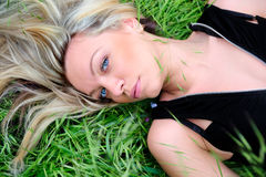 Female lying on grass Royalty Free Stock Image