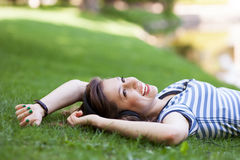 Female lying on grass Stock Images