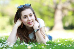 Female lying on grass Royalty Free Stock Images