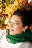 Female lying on the leaves Royalty Free Stock Photography