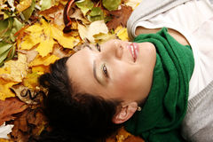Female lying on the leaves Stock Photography