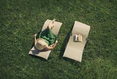 Female lying on sunbed Royalty Free Stock Photo