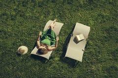 Female lying on sunbed Stock Photography