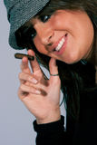 Female Mafia boss style. Smiling with cigar. Royalty Free Stock Photo