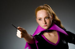 Female magician doing tricks Royalty Free Stock Image