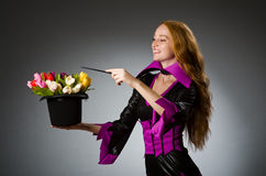 Female magician doing tricks Stock Photos