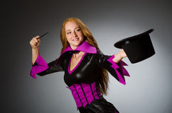 Female magician doing tricks Stock Photography