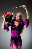 Female magician doing tricks Stock Photos