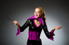 Female magician doing tricks Royalty Free Stock Photography