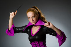 Female magician doing tricks Royalty Free Stock Photo