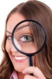 Female with magnifying glass Royalty Free Stock Photos