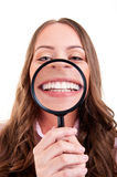 Female with magnifying glass Royalty Free Stock Images