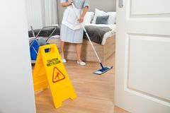 Female maid cleaning floor Royalty Free Stock Photography