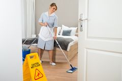 Female maid cleaning floor Royalty Free Stock Photo
