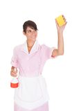 Female Maid With Sponge And Bottle Royalty Free Stock Photo
