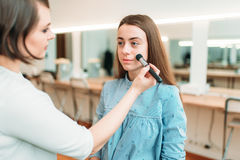 Female make up artist work with woman face Royalty Free Stock Photography