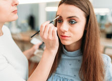 Female make up artist work with woman face Stock Photos