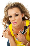 Female makeup. Beautiful young woman is preparing to apply makeup Stock Photo