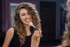 Female makeup artist applying brush. stock images