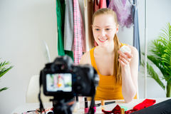 Female makeup blogger. Female blogger making a makeup tutorial at office Royalty Free Stock Image