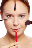 Female with makeup tools Royalty Free Stock Image