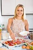 Female making Italian pizza Stock Photography