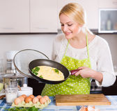 Female making omelet at home Stock Image