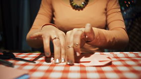 Female making origami heart from pink paper for valentines day stock footage