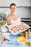 Female making tasty Italian pizza Stock Image