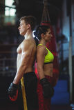 Female and male boxer standing back to back Royalty Free Stock Photo
