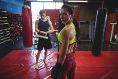 Female and male boxer standing in fitness studio. During practice stock images