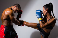 Female and male boxers. With boxing gloves during a match, isolated on studio Royalty Free Stock Photo