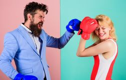 Female and male boxers fighting in gloves. Domination concept. Gender battle. Gender equal rights. Gender equality. Man royalty free stock photography