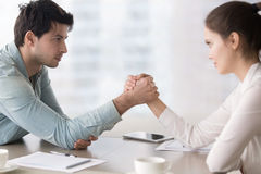 Female and male business rivals armwrestling, competing for lead Royalty Free Stock Images