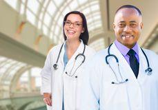 Female and Male Caucasian and African American Doctors in Hospit Stock Images