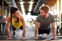 Female and male compete in endurance. On fitness training Stock Images