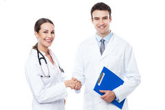 Female and male doctors handshaking Royalty Free Stock Images