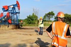 Two land surveyors at work stock photo
